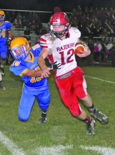 Bellefonte High School's Cade Fortney gets tackled by Chestnut Ridge High School's Dalton Seese (75) in the Lions' 41-21 win on Friday. (Bedford Gazette/Sam Shuss)