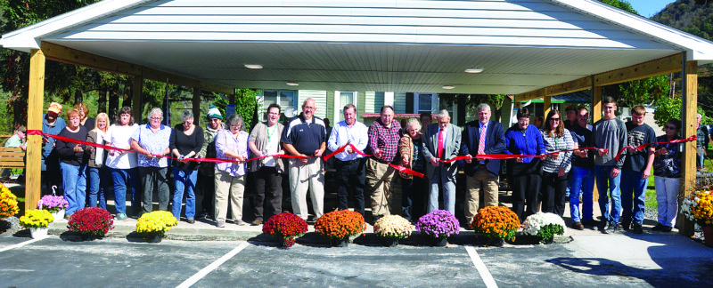 KEVIN RAUCH/THE EXPRESS At top the ribbon is cut to open the new pavilion.