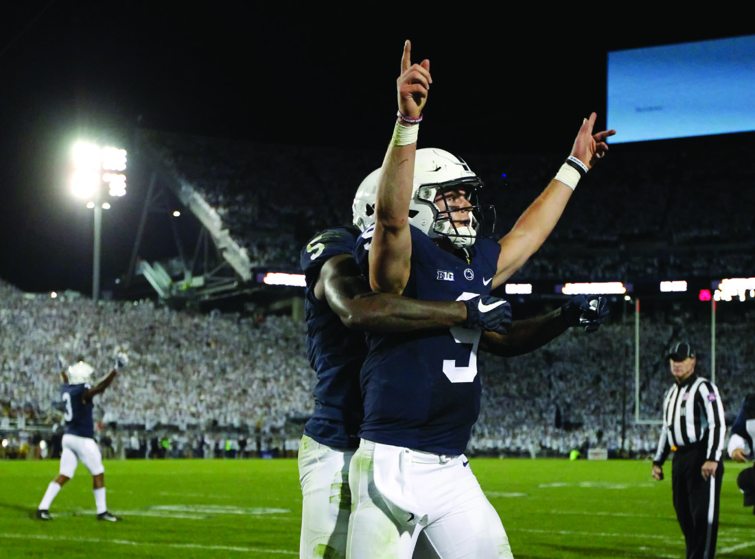 Penn State quarterback Trace McSorley (9) celebrates with DaeSean Hamilton after scoring a touchdown against Michigan during the second half of an NCAA college football game in State College, Pa., Saturday, Oct. 21, 2017. Penn State won 42-13. (AP Photo/Chris Knight)