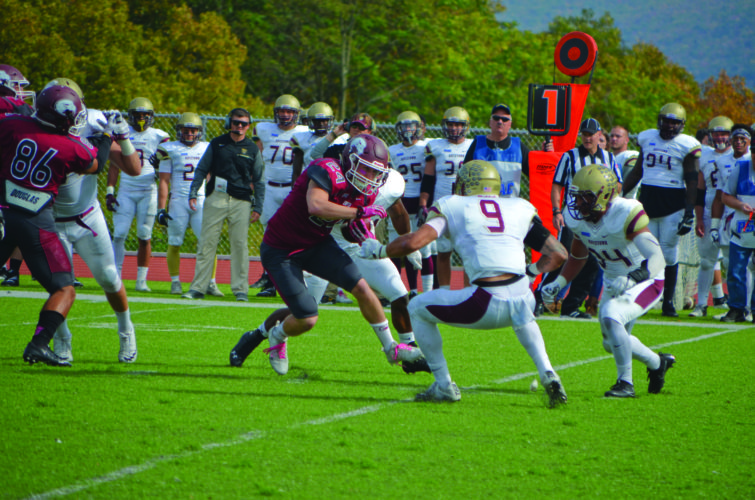 John Ford (24) of Lock Haven University runs against the defense of Kutztown University in a 55-26 loss. (The Express/Phil Mapstone)