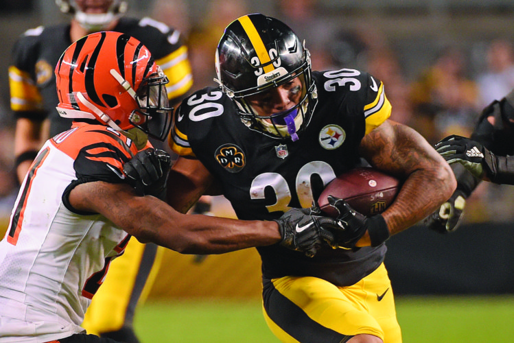 Pittsburgh Steelers running back James Conner (30) is tackled by Cincinnati Bengals cornerback Darqueze Dennard (21) during the second half of an NFL football game in Pittsburgh, Sunday, Oct. 22, 2017. The Steelers won 29-14. (AP Photo/Fred Vuich)