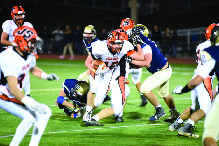 Jersey Shore's Kyle Tomb runs the football.