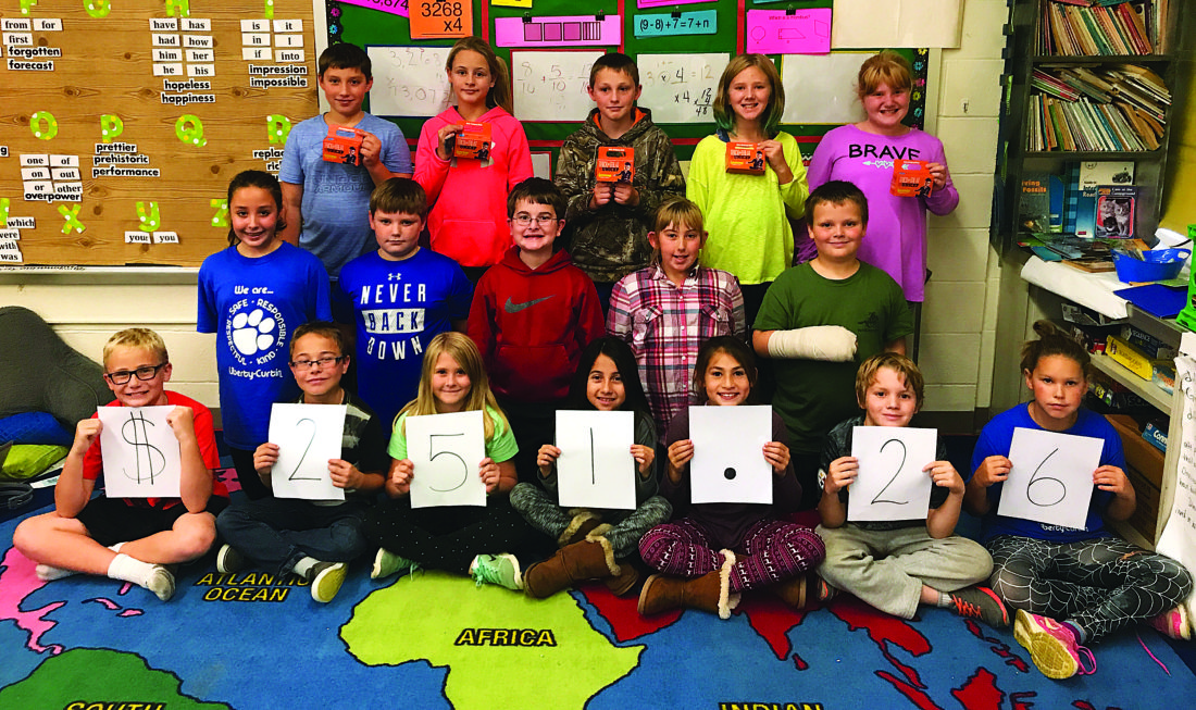 PHOTO PROVIDED BY PRELLA SMITH/LIBERTY-CURTIN  Students from Mrs. Smith's fourth-grade class at Liberty-Curtin hold up the amount of money they raised through Trick-or-Treat for UNICEF.