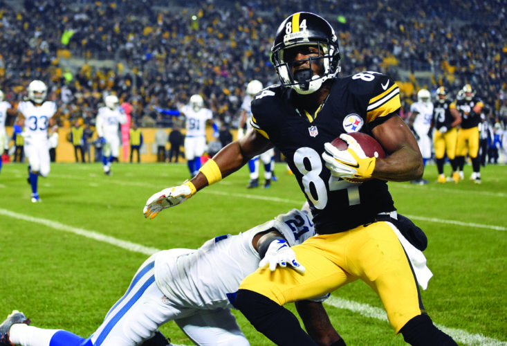 FILE - In this Dec. 6, 2015, file photo, Pittsburgh Steelers wide receiver Antonio Brown (84) catches a touchdown pass from quarterback Ben Roethlisberger as Indianapolis Colts cornerback Vontae Davis (21) defends during the first half of an NFL football game in Pittsburgh. Roethlisberger and Brown have masterfully dissected the ColtsÕ secondary, turning potentially competitive games into blowouts.  (AP Photo/Fred Vuich, File)