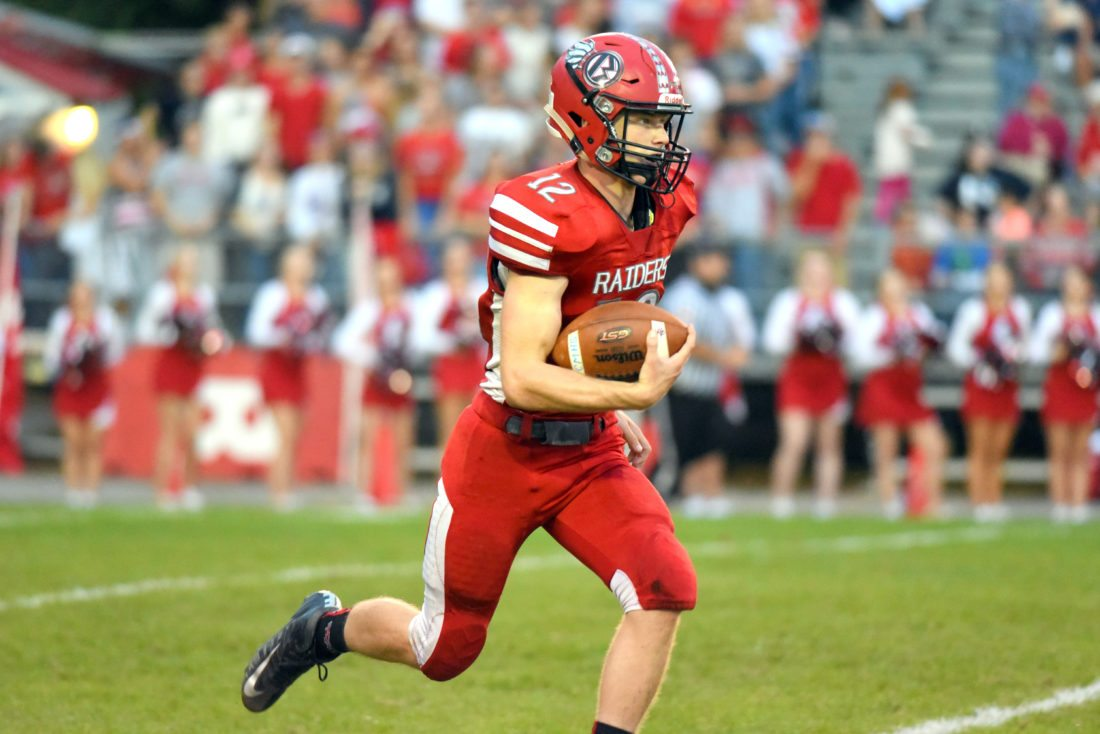 Cade Fortney runs the ball against Central Mountain. The Red Raiders travel to Hollidaysburg tonight to face Greater Johnstown in the district championship.