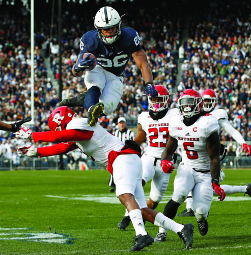 Penn State's Saquon Barkley (26) hurdles Rutgers' Kiy Hester (2) during the second half of an NCAA college football game in State College, Pa., Saturday, Nov. 11, 2017. Penn State 35-6. (AP Photo/Chris Knight)