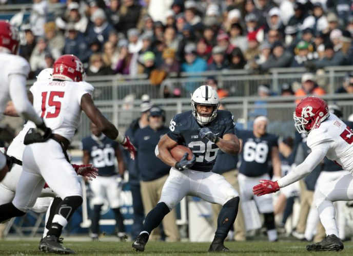 Penn State's Saquon Barkley (26) looks for running room against Rutgers during the second half of an NCAA college football game in State College, Pa., Saturday, Nov. 11, 2017. Penn State 35-6. (AP Photo/Chris Knight)