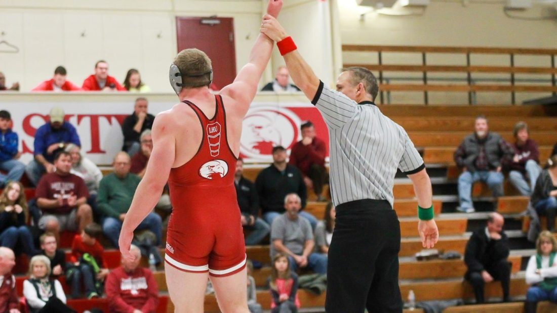 Junior Tristan Sponseller (left) of Lock Haven University gets his hand risen after a NCAAcollege wrestling victory. (Photo courtesy of LHU Wrestling)
