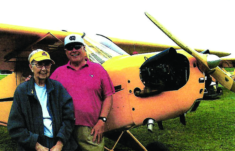 PHOTO PROVIDED From left, Leah Jones and Bob Epting stand next to a Piper Cub.