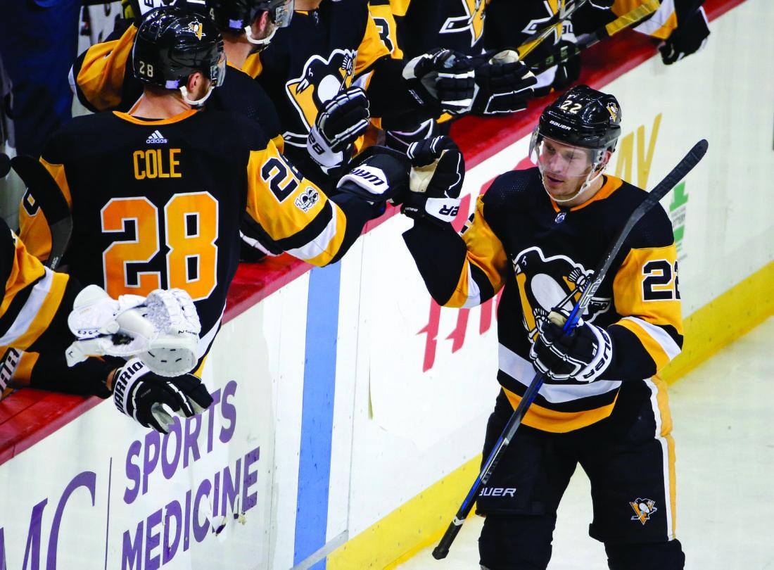 Pittsburgh Penguins' Matt Hunwick (22) returns to his bench after scoring in the third period of an NHL hockey game against the Chicago Blackhawks in Pittsburgh, Saturday, Nov. 18, 2017. The Blackhawks won 2-1. (AP Photo/Gene J. Puskar)