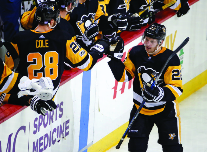 Pittsburgh Penguins' Matt Hunwick (22) returns to his bench after scoring in the third period of an NHL hockey game against the Chicago Blackhawks in Pittsburgh, Saturday, Nov. 18, 2017. The Blackhawks won 2-1. (AP Photo/Gene J. Puskar)