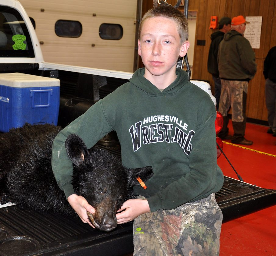 KEVIN RAUCH/THE EXPRESS Eli Olshefskie, 12, bagged this 132-pound female on Saturday.