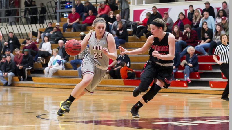 Junior guard Madison McHale (24) of the Lock Haven University women's basketball team drives the ball into the paint in an NCAAwomen's college basketball game. (Photo courtesy of LHU asketball)