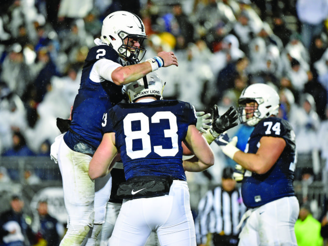 Penn State quarterback Tommy Stevens (2) celebrates with Alex Hoenstine (83) after Hoenstine's touchdown in the second half of an NCAA college football game against Nebraska, Saturday, Nov. 18, 2017, in State College, Pa. (Chris Dunn/York Daily Record via AP)