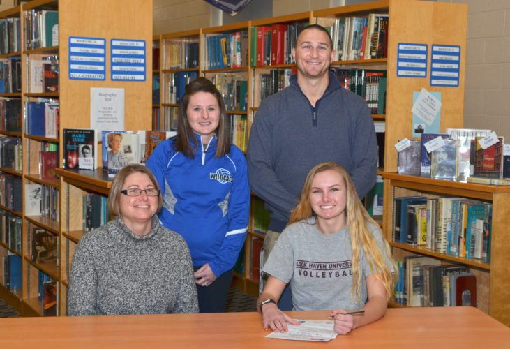 Jada Dauberman (bottom right), senior of CM volleyball, signs her letter of intent with LHU. Dauberman is pictured with her mother, Susan (bottom left) and CM head coach Megan Ulsamer (top left) and Athletic Director George Bidwell. (top right) (The Express/Phil Mapstone)