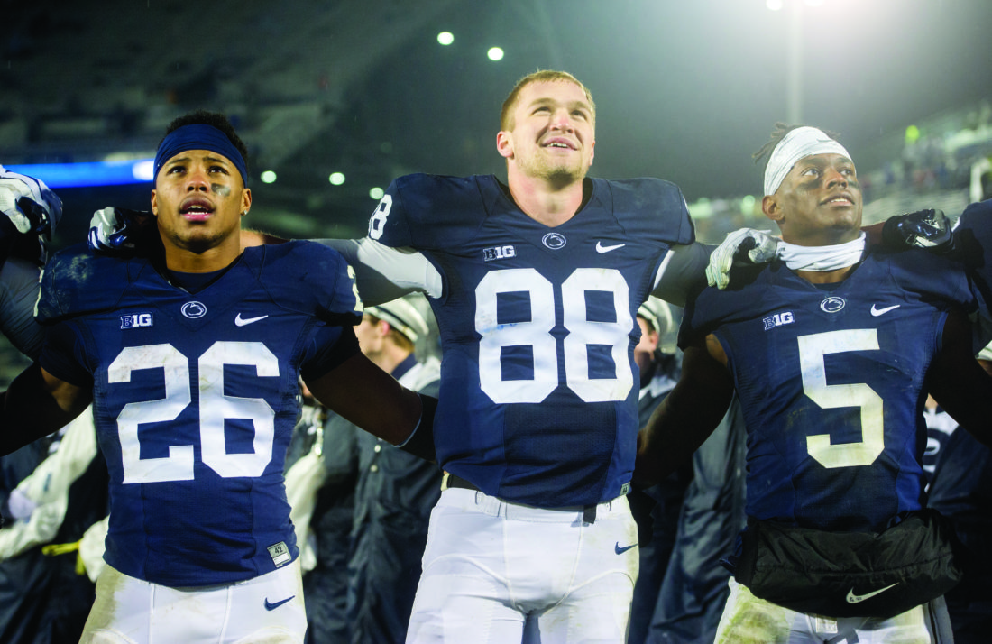 Penn State running back Saquon Barkley, tight end Mike Gesicki and wide receiver DaeSean Hamilton link arms to sing the alma mater after an NCAA college football game against Nebraska, Saturday, Nov. 18, 2017, in State College, Pa. (Abby Drey/Centre Daily Times via AP)