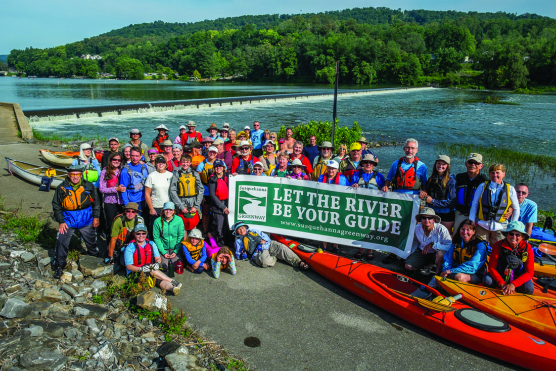 Kayakers pose for a photo in Lock Haven during the West Branch Sojourn.