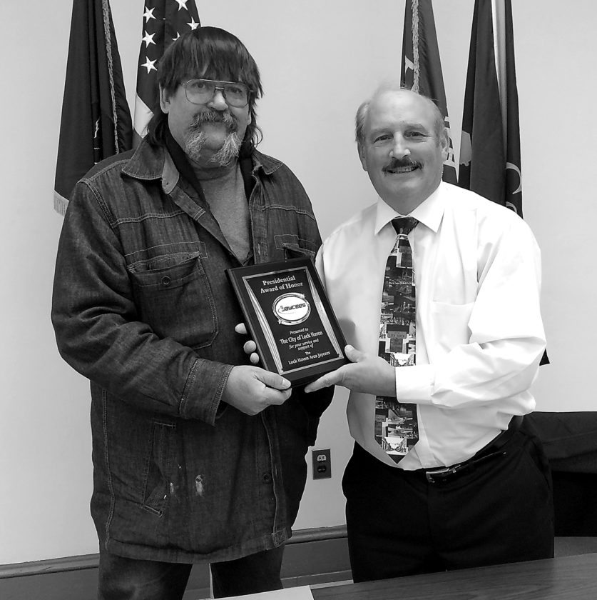 WENDY STIVER/THE EXPRESS Lock Haven Mayor William E. Baney III, right, receives the Presidential Award of Honor on behalf of the city from the Lock Haven Area Jaycees. DuWayne Kunes, left, presented it Monday.