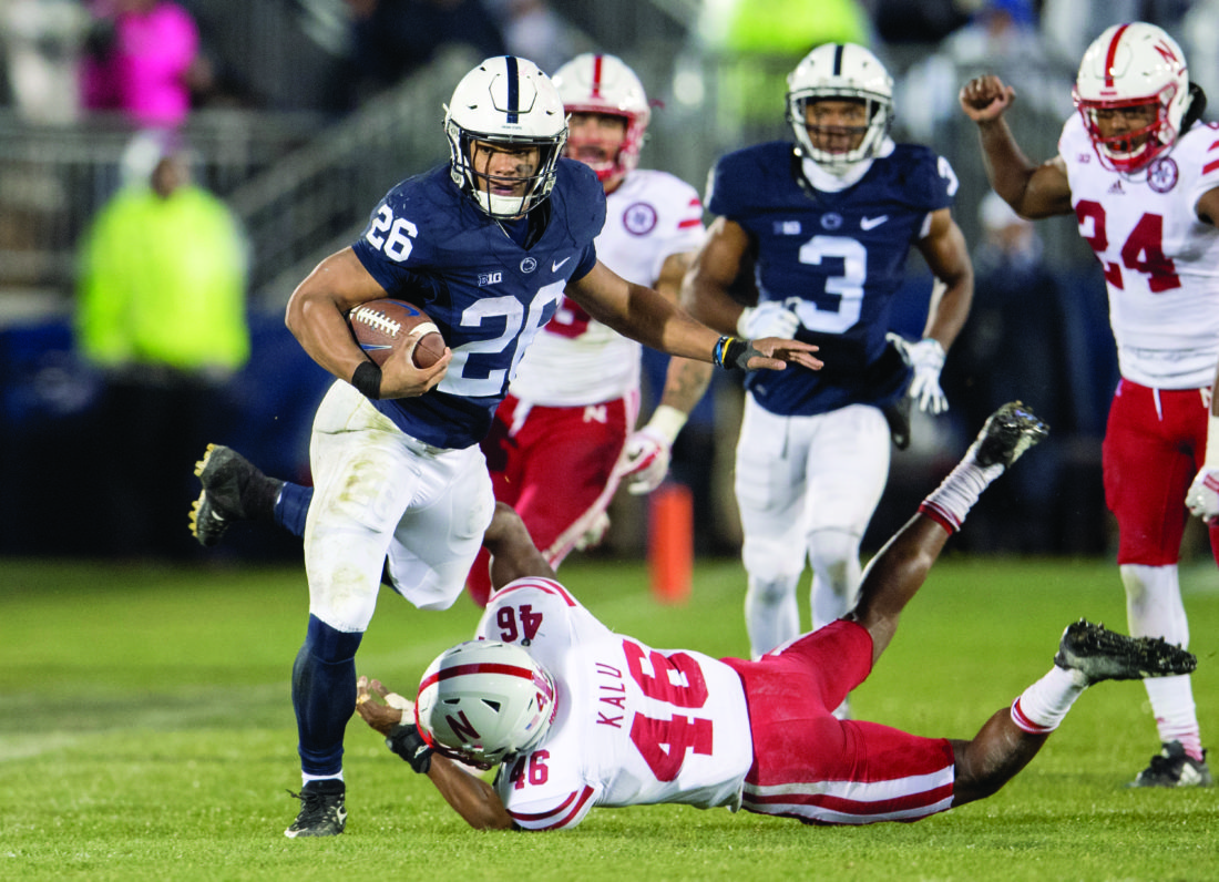 Penn State running back Saquon Barkley dodges the tackles from Nebraska defensive back Joshua Kalu during an NCAA college football game Saturday, Nov. 18, 2017, in State College, Pa. (Abby Drey/Centre Daily Times via AP)