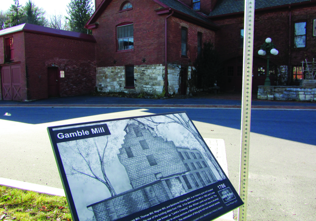 EMMA GOSALVEZ/THE EXPRESS This tablet in front of the historic Gamble Mill was one of the first two tablets to be installed. The other is at Dunlop Street. The goal is to have all six installed by Bellefonte Victorian Christmas.