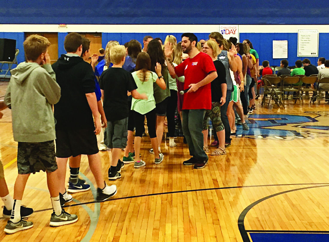 PHOTO PROVIDED Student participants are welcomed into the Central Mountain Middle School gym with high fives, cheers and upbeat music to get them pumped for Challenge Day 2017.
