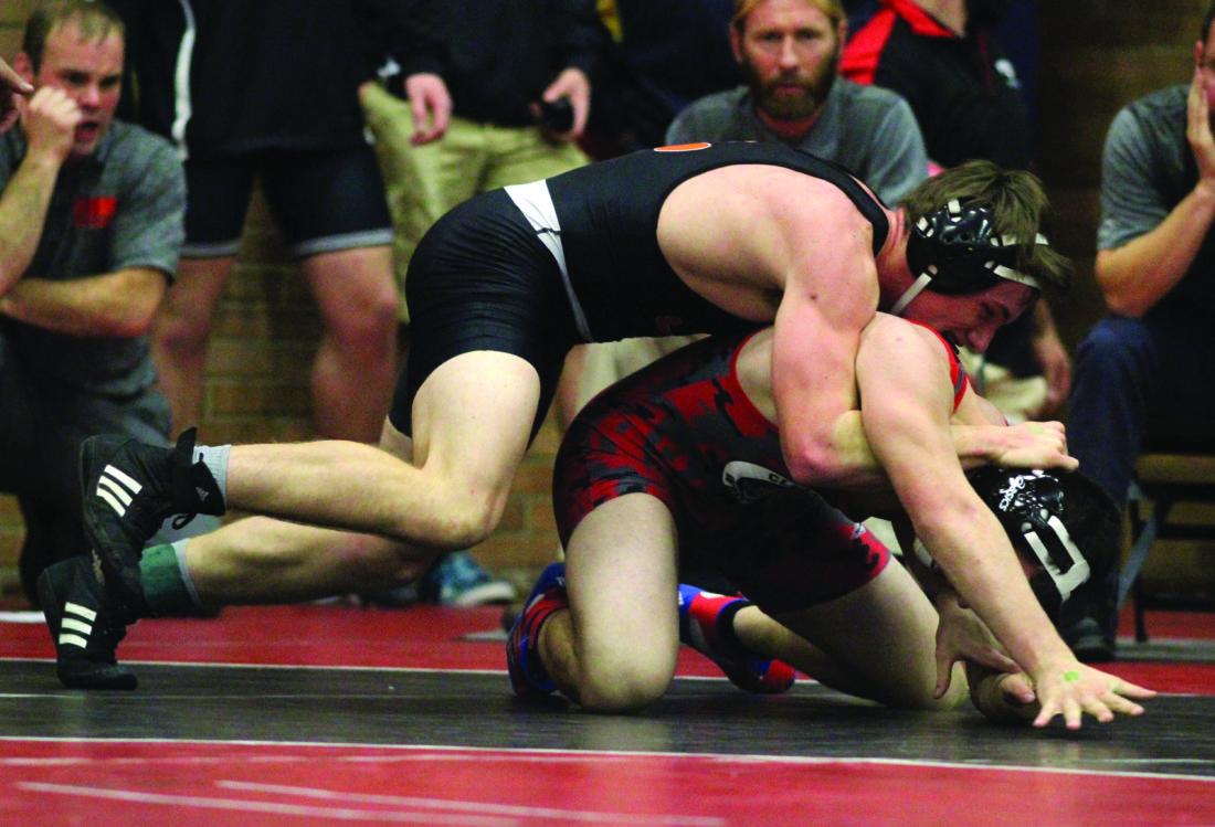 Jersey Shore High School's Kyle Tomb wrestles Clearfield High School's Brett Zatoni during a 170lb match at the Top Hat Tournament Friday at Williamsport High School. KAREN VIBERT-KENNEDY/Sun-Gazette