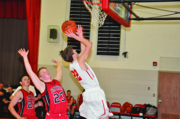 Bucktail's Gabe Conway (22) attempts a lay-up with Austin's Blake Burgett on defense. Austin won, 68-43. (The Express/Kevin Rauch)