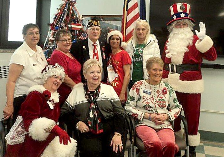 PHOTO PROVIDED On the Legion Family Hospital Christmas Tour were, from left, seated: B.J. Lysic, aka Mrs. Santa Claus, a past Department of Pennsylvania American Legion Auxiliary president; Mary Greiman, current president of the Department of Pennsylvania ALA; and Carol Wert Walker, ALA district president and treasurer of ALA Unit #131 in Lock Haven; and standing: Ruth Bowmaster, first vice president of ALA Unit #131; Dori Schenck, president of ALA Unit #131; Wayne Walker of the American Legion Post #36 of Jersey Shore; Denise Haight, second vice president of ALA Unit #131; Tammy Wynn, member of ALA Unit #131; and Jim Hales, aka Uncle Sammy Claus, a past Department of Pennsylvania American Legion commander.