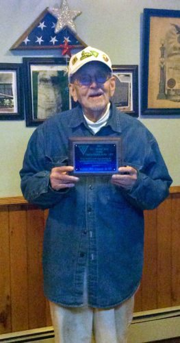 PHOTO PROVIDED William Lantz, a veteran of Korea, shows the national award that Voiture 903 of the 40 & 8 at Lock Haven received. He is the Pennsylvania director of 40 & 8 youth sports and is very involved in the Special Olympics.