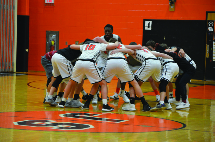 The Jersey Shore High School boy's basketball team gets hyped before a high school basketball game against Midd-West High School last night in Jersey Shore, PA. The Bulldogs took home the victory, 55-34. (The Express/Phil Mapstone)
