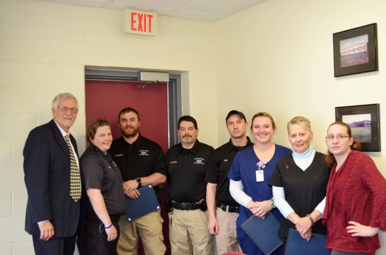 SARAH PAEZ/THE EXPRESS From left, Warden John Rowley, Lt. Jane Powell, Correctional Officer Andrew Cooper, Correctional Officer Joseph Blazina, Correctional Officer Zachary Ohl, RN Ashley Bechdel, RN Holly Barrett and Health Services Administrator Jodie Baney pose for a photo.