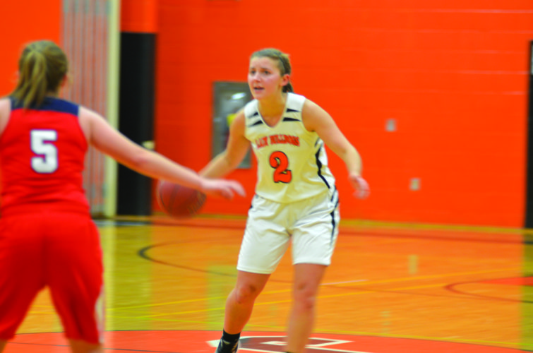 Senior guard Averie Hess (2) of Jersey Shore High School dribbles the ball down the court against Juniata. (The Express Photo)