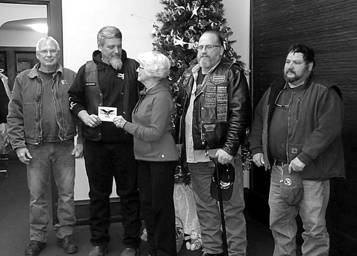 Pictured are Big Twins members, from left, Ed Schners, treasurer; Perry Killinger, vice president, presenting the check to Pastor Champion; Keith Harman, president, and Jeff McHenry, trustee.