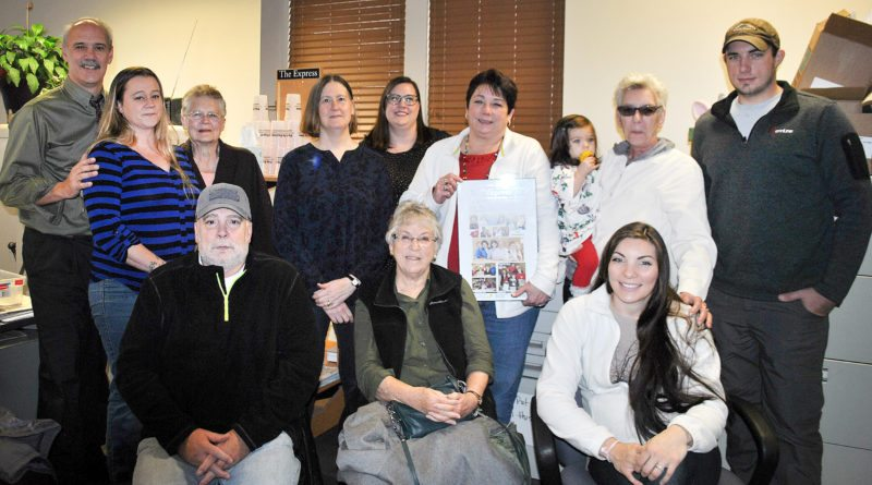 Among the many on hand were, from left, Bob Rolley, Danielle Miller, Lee Locke (seated), Linda Hinton, Stephanie Maresch, Jessica Stokes, Peggy Dorey (seated), Tina, her granddaughter Aubrey held by Tina's sister Mary Frances Severino, her daughter-in-law Heather Geyer (seated), and son Josh Geyer.