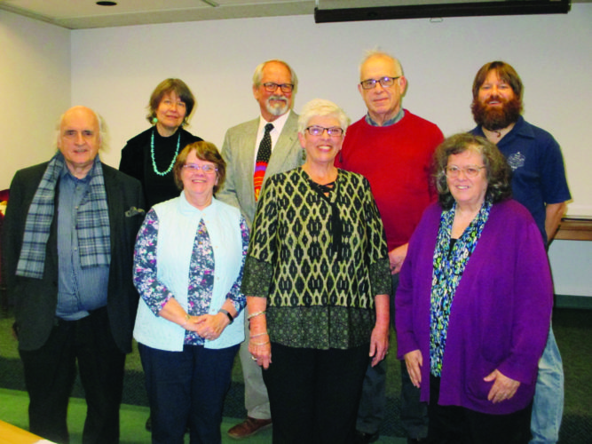 WENDY STIVER/THE EXPRESS Ross Library Director Diane L. Whitaker, right front, was honored with a reception Dec. 9 for her upcoming retirement. Members of the Ross Library Board of Trustees attending were, from left, in front: Richard Morris, Martha Sykes and Mary Jane Isenberg with Whitaker; and in back: Elsa Winch, president Eric Fletcher, Art Sanders and Jared Conti.