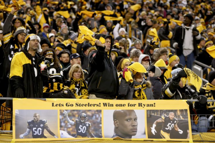 Pittsburgh Steelers' fans cheer behind a sign showing support for injured inside linebacker Ryan Shazier (50) during an NFL football game against the Baltimore Ravens, Sunday, Dec. 10, 2017, in Pittsburgh. (AP Photo/Keith Srakocic)