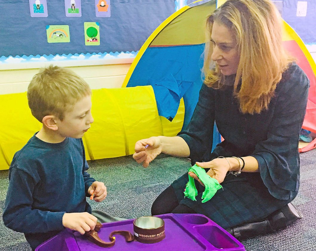 PHOTOS PROVIDED Wingate Elementary second-grade student, Garek Brown, and BEA occupational therapist, Megan Weisbrode, look for hidden objects in TheraPutty. This is a calming tactile activity that provides strong sensory input to the hands.