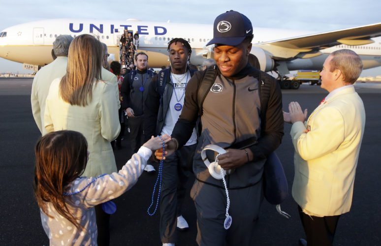 Penn State players are greeted by volunteers in preparation for an upcoming NCAA college football bowl game against Washington, Saturday, Dec. 23, 2017, in Phoenix. (AP Photo/Rick Scuteri)
