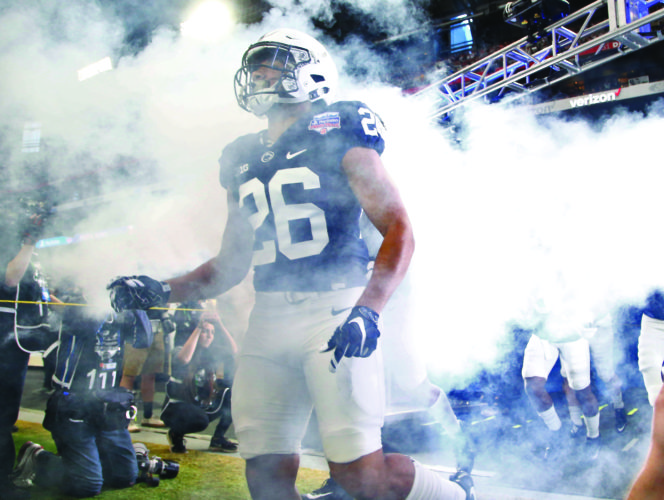 Penn State running back Saquon Barkley (26) the field with his teammates prior to the Fiesta Bowl NCAA college football game against Washington, Saturday, Dec. 30, 2017, in Glendale, Ariz. (AP Photo/Ross D. Franklin)