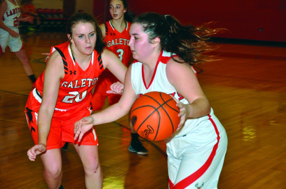 Bucktail's Maria D'Onofrio and her team-high 14 points made her the target of a stingy Galeton defense, as C. Parsell looks to shut down a drive the senior attempted late in the fourth quarter. (The Express/Kevin Rauch)