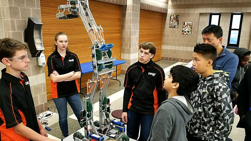 PHOTO PROVIDED  JSHS VEX team members display their robot at a competition, From left are Owen Knepp, Rachel Garrett, and Ryan Stratton.