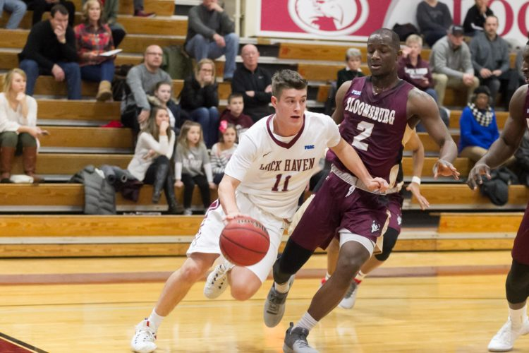 Matt Cerruti (11) of Lock Haven University drives into the paint in an NCAA men's college basketball game. (Photo courtesy of LHU Men's Basketball)