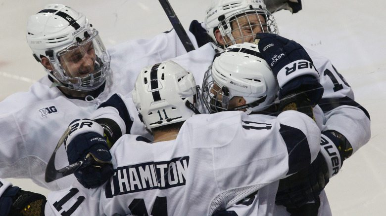 Penn State's Chase Berger (8) is congratulated on his goal  against Wisconsin in the second period on Jan. 5, 2018.  No. 14 Penn State defeated No. 15. Wisconsin 5-1.  Photo/Craig Houtz