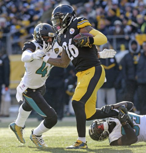 Pittsburgh Steelers running back Le'Veon Bell (26) is tackled by Jacksonville Jaguars free safety Tashaun Gipson, lower right, and strong safety Barry Church, left, during the first half of an NFL divisional football AFC playoff game in Pittsburgh, Sunday, Jan. 14, 2018. (AP Photo/Don Wright)