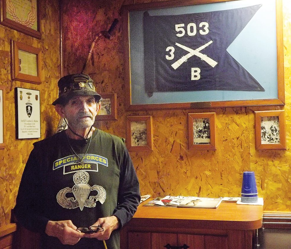 LAURA JAMESON/THE EXPRESS Vietnam veteran Graydon Klobe is seen in his Rauchtown home under a flag given to him by an officer from his brigade.