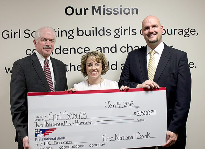 PHOTO PROVIDED Presenting a check for $2,500 to Ellen M. Kyzer, CEO and president of Girl Scouts in the Heart of Pennsylvania, are First National Bank representatives Ed Barben, senior vice president and private banking team leader, and Greg Conrad, senior vice president and regional banking executive.