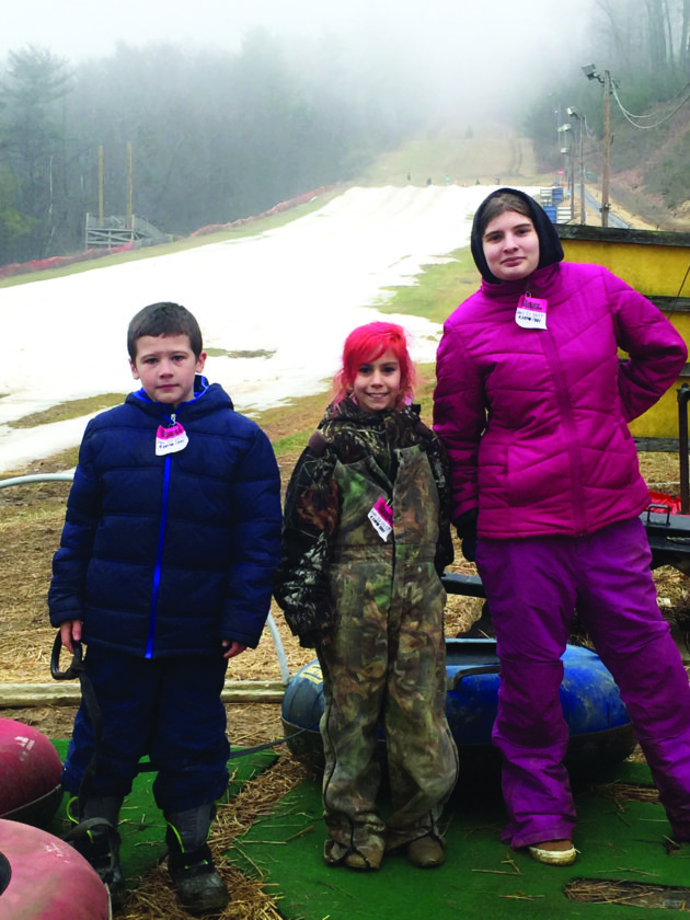 Christian Caris, Neveah Reigel and Rochelle Page are seen snow tubing at Tussey Mountain.  PHOTOS PROVIDED