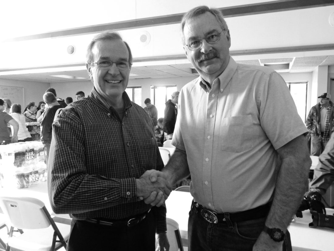 ROSE HOOVER/FOR THE EXPRESS Mountaintop Regional Water Authority Board of Directors member Jim Yost, left, thanks Rep. Mike Hanna for his efforts to help the Mountaintop community.