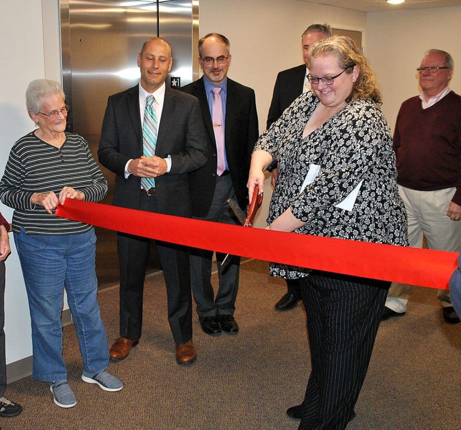 Cheryl Sinclair, project manager, smiles as she cuts the ribbon and welcomes residents to the new Lock Haven Court apartments.