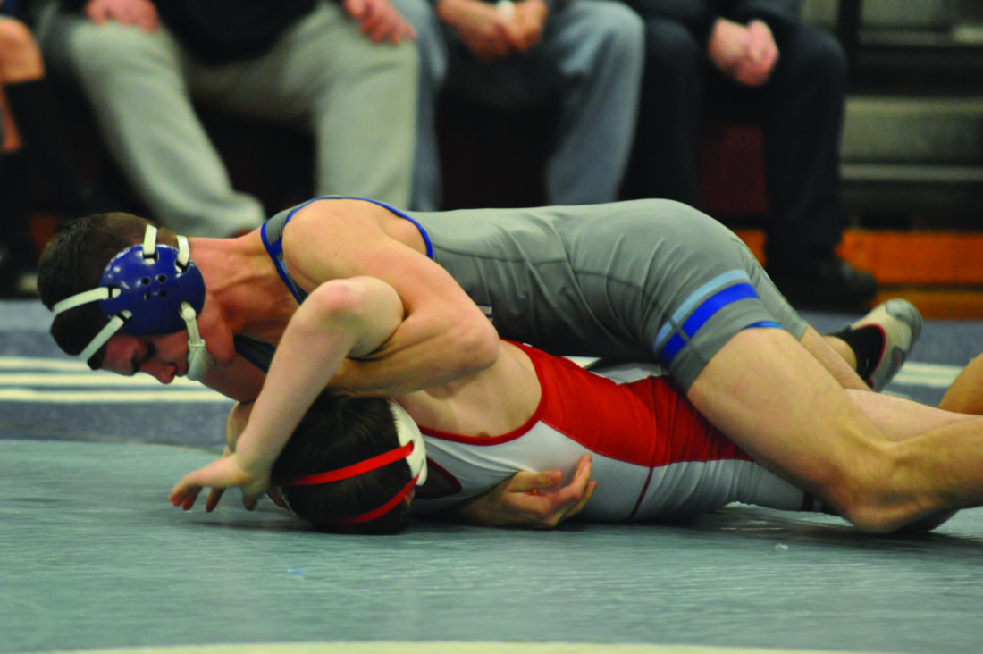 Bucktail senior and Central Mountain's 145 pounder Logan Long's pin over Bellefonte's Kenneth Simpson was the first match of the night and set the tone for the Central Mountain and Bucktail fans as they celebrated a 50-15 Wildcats win. (The Express/Kevin Rauch)